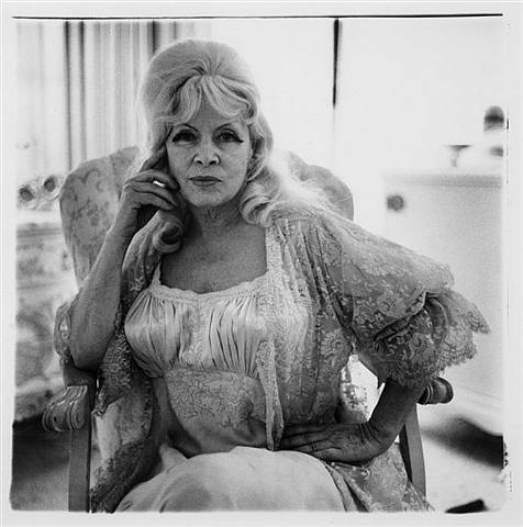 Mae West in a Chair at Home